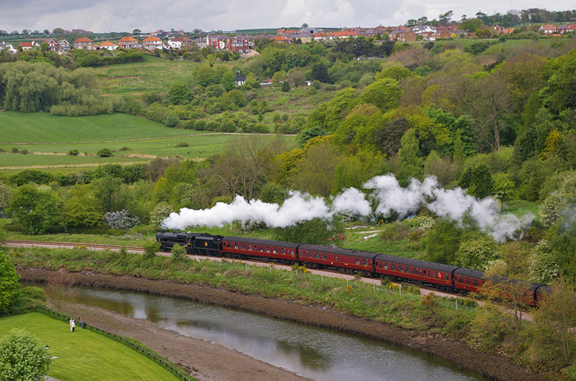 Steam train passing under Larpool Viaduct/photo by Arnold Underwood/May 2009